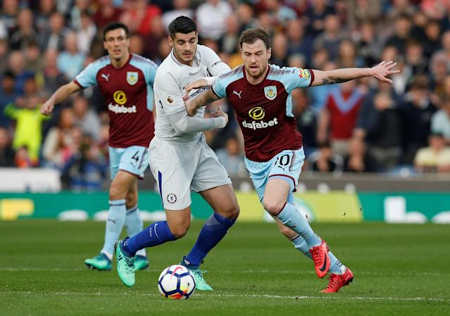 "Soccer Football - Premier League - Burnley vs Chelsea - Turf Moor, Burnley, Britain - April 19, 2018 Burnley's Ashley Barnes in action with Chelsea's Alvaro Morata REUTERS/Andrew Yates EDITORIAL USE ONLY. No use with unauthorized audio, video, data, fixture lists, club/league logos or ""live"" services. Online in-match use limited to 75 images, no video emulation. No use in betting, games or single club/league/player publications. Please contact your account representative for further details."