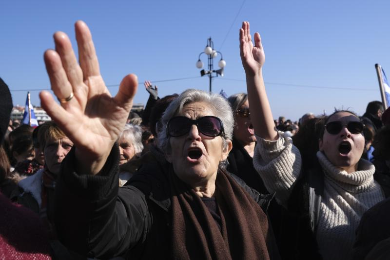 Protesters shout slogans outside the Municipality of Mytilene during a rally on the northeastern Aegean island of Lesbos, Greece, on Wednesday, Jan. 22, 2020. Local residents and business owners have launched a day of protest on the Greek islands hardest hit by migration, demanding the Greek government ease severe overcrowding at refugee camps. (AP Photo/Aggelos Barai)