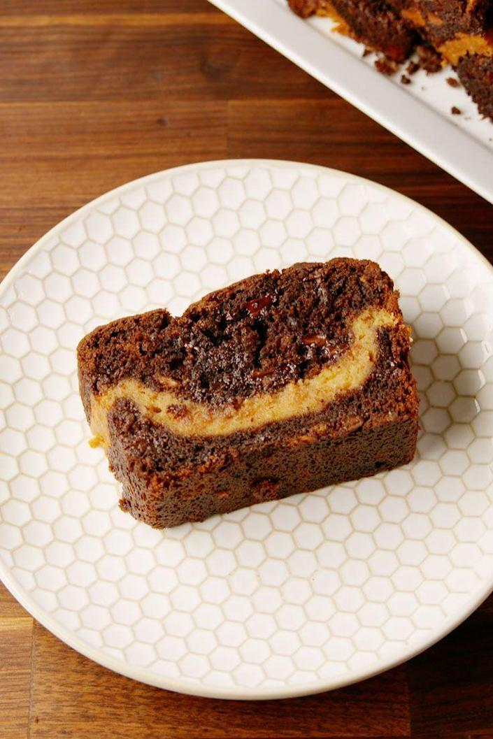 """<p>Just wait until you see that peanut butter layer.</p><p>Get the recipe from <a href=""""https://www.delish.com/cooking/recipe-ideas/recipes/a57474/buckeye-banana-bread-recipe/"""" rel=""""nofollow noopener"""" target=""""_blank"""" data-ylk=""""slk:Delish"""" class=""""link rapid-noclick-resp"""">Delish</a>.</p><p><a class=""""link rapid-noclick-resp"""" href=""""https://www.amazon.com/USA-Pan-Bakeware-Aluminized-Steel/dp/B0029JQEIC/?tag=syn-yahoo-20&ascsubtag=%5Bartid%7C1782.g.2145%5Bsrc%7Cyahoo-us"""" rel=""""nofollow noopener"""" target=""""_blank"""" data-ylk=""""slk:BUY NOW"""">BUY NOW</a> <strong><em>Loaf Pan, $15, amazon.com</em></strong></p>"""