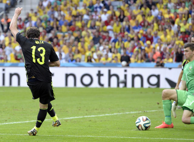 Spain's Juan Mata scores his team's third goal during the group B World Cup soccer match between Australia and Spain at the Arena da Baixada in Curitiba, Brazil, Monday, June 23, 2014. (AP Photo/Manu Fernandez)