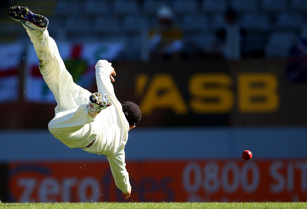 AUCKLAND, NEW ZEALAND - MARCH 26:  Brendon McCullum of New Zealand dives for the ball  during day five of the Third Test match between New Zealand and England at Eden Park on March 26, 2013 in Auckland, New Zealand.  (Photo by Phil Walter/Getty Images)