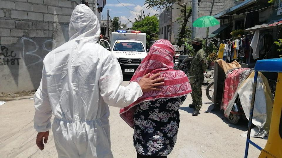 A mother being arrested in Taguig City in 2020 for allegedly exposing her children to pedophiles online. Photo: Philippine National Police