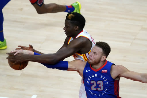 Detroit Pistons forward Blake Griffin (23) and Atlanta Hawks center Clint Capela vie for control of the ball during the second half of an NBA basketball game Wednesday, Jan. 20, 2021, in Atlanta. (AP Photo/John Bazemore)