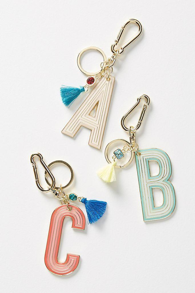 """<p><strong>Anthropologie</strong></p><p>anthropologie.com</p><p><strong>$18.00</strong></p><p><a href=""""https://go.redirectingat.com?id=74968X1596630&url=https%3A%2F%2Fwww.anthropologie.com%2Fshop%2Fmonogram-keychain3&sref=https%3A%2F%2Fwww.countryliving.com%2Fshopping%2Fgifts%2Fg34500004%2Fmonogram-gift-ideas%2F"""" rel=""""nofollow noopener"""" target=""""_blank"""" data-ylk=""""slk:Shop Now"""" class=""""link rapid-noclick-resp"""">Shop Now</a></p><p>Personalize your keys, wallet, or purse with this sweetly tasseled keychain.</p>"""