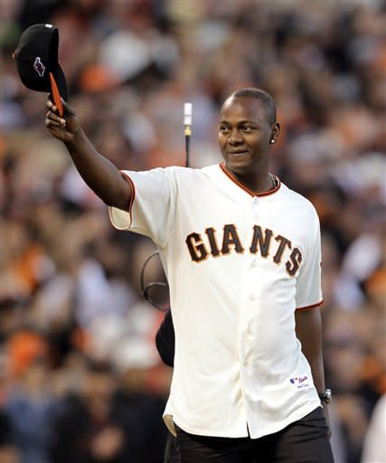 Former San Francisco Giants' Edgar Renteria throws out the ceremonial first pitch during Game 2 of the National League division baseball series against the Cincinnati Reds in San Francisco, Sunday, Oct. 7, 2012. (AP Photo/Eric Risberg)
