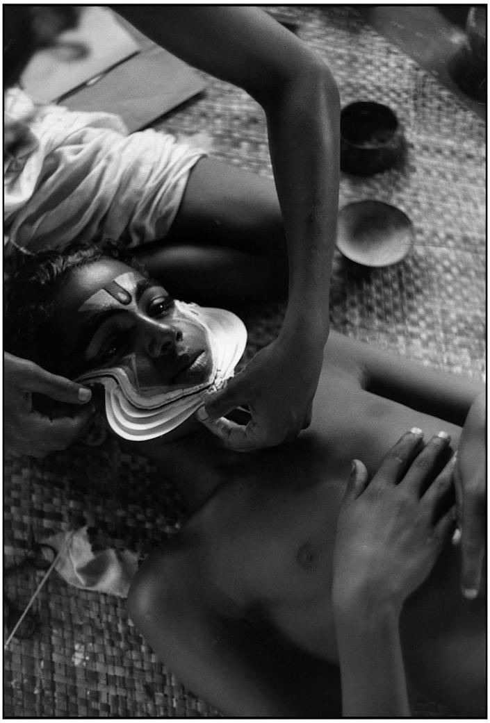 """<p>""""Kathakali actors being made up for a performance from the Mahabharata."""" Cheruthuruthi, Kerala, India • 1950. (Photo: Henri Cartier-Bresson/Magnum Photos) </p>"""