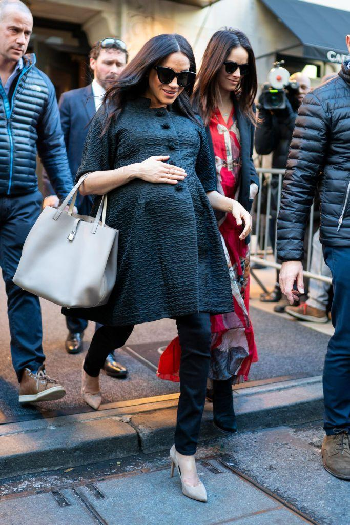 <p>The Duchess of Sussex wore a Courrèges Haute Couture black trapeze coat in matelassé silk, from circa 1965 via William Vintage to her bridal shower in New York. </p>