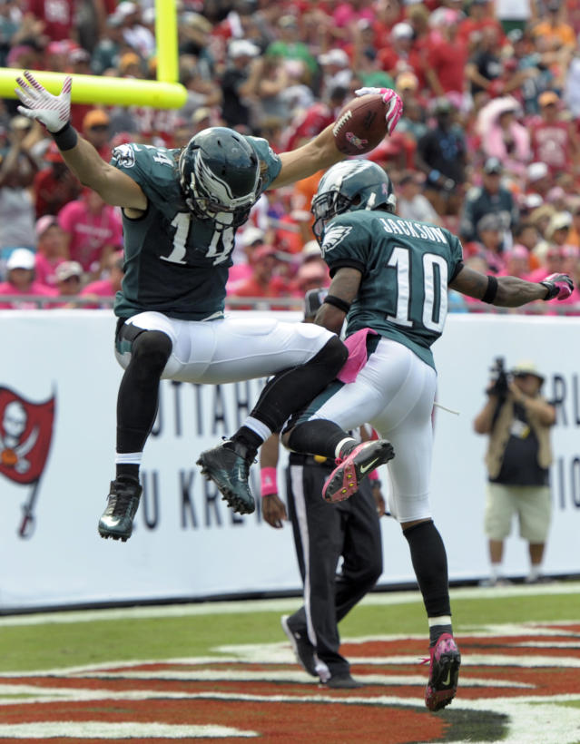 Philadelphia Eagles wide receiver Riley Cooper (14) celebrates with teammate wide receiver DeSean Jackson (10) after scoring on a 47-yard touchdown reception against the Tampa Bay Buccaneers during the third quarter of an NFL football game Sunday, Oct. 13, 2013, in Tampa, Fla. (AP Photo/Steve Nesius)