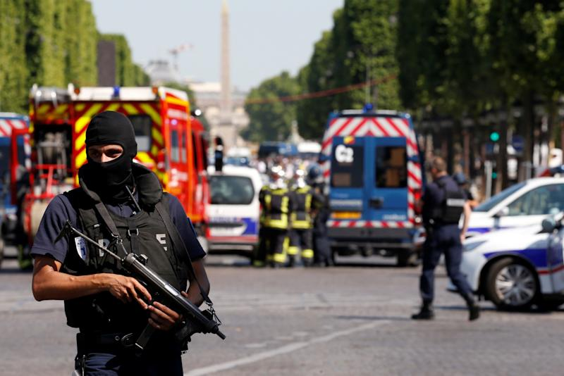 Policemen secure the area on the Champs Elysees avenue after an incident in Paris (Reuters)