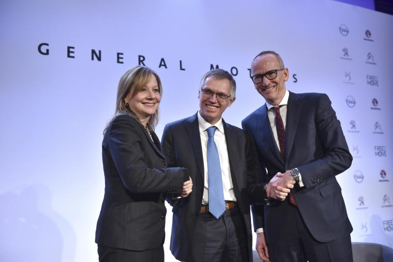 <p> CEO of PSA Carlos Tavares, Opel CEO Karl-Thomas Neumann, right, and GM CEO Mary Barra, left, pose for photographers after addressing the media in Paris, France, Monday, March 6, 2017. General Motors is selling its loss-making European car business, including Germany's Opel and British brand Vauxhall, to France's PSA group in a deal that realigns the industry in the region. (AP Photo/Zacharie Scheurer) </p>