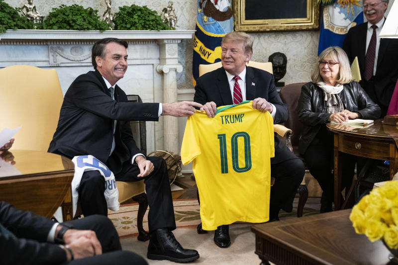 """""""I have always admired the United States of America, and this sense of admiration has increased since you took office,"""" Bolsonaro told Trump during a White House visit on Tuesday. (The Washington Post via Getty Images)"""