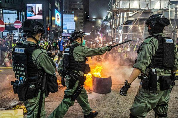 PHOTO: Police stand guard on a road to deter pro-democracy protesters from blocking roads in the Mong Kok district of Hong Kong on May 27, 2020, as the city's legislature debates over a law that bans insulting China's national anthem. (AFP via Getty Images, FILE)