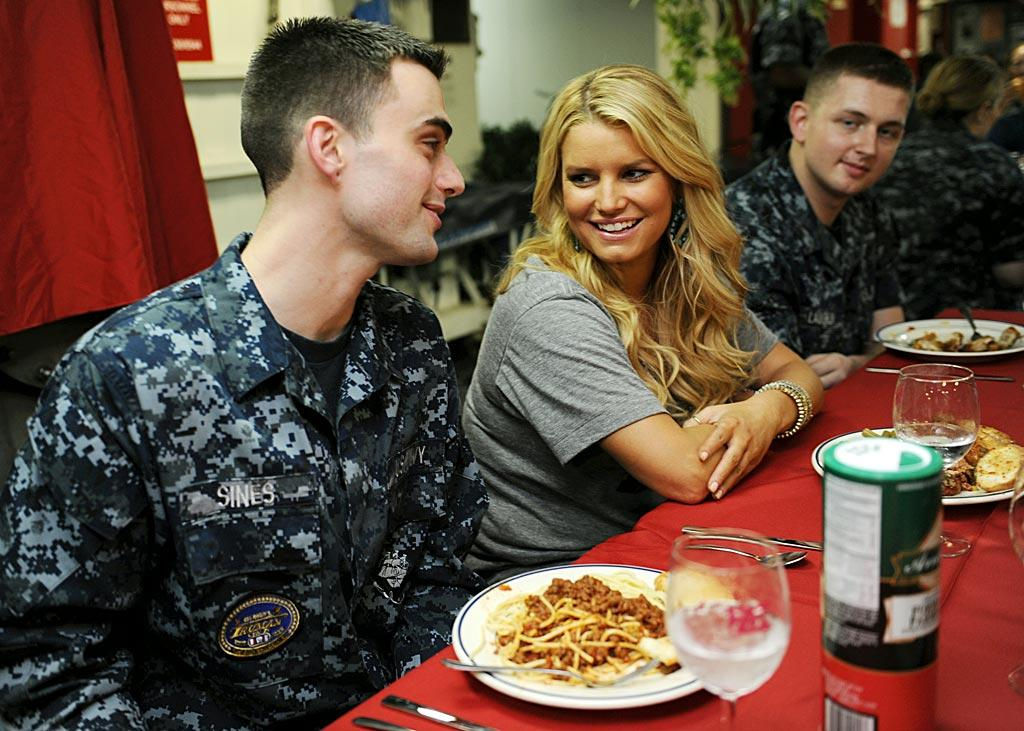 """Jessica Simpson hung out with the troops during a USO and Navy Entertainment sponsored trip to the aircraft carrier USS Harry S. Truman, which is currently based in the Persian Gulf. After returning to the U.S., the singer tweeted: """"Feel so humbled by the sacrifice the troops and their families make to keep us safe. I'm forever changed after this last week. Thank you!"""" US Navy"""