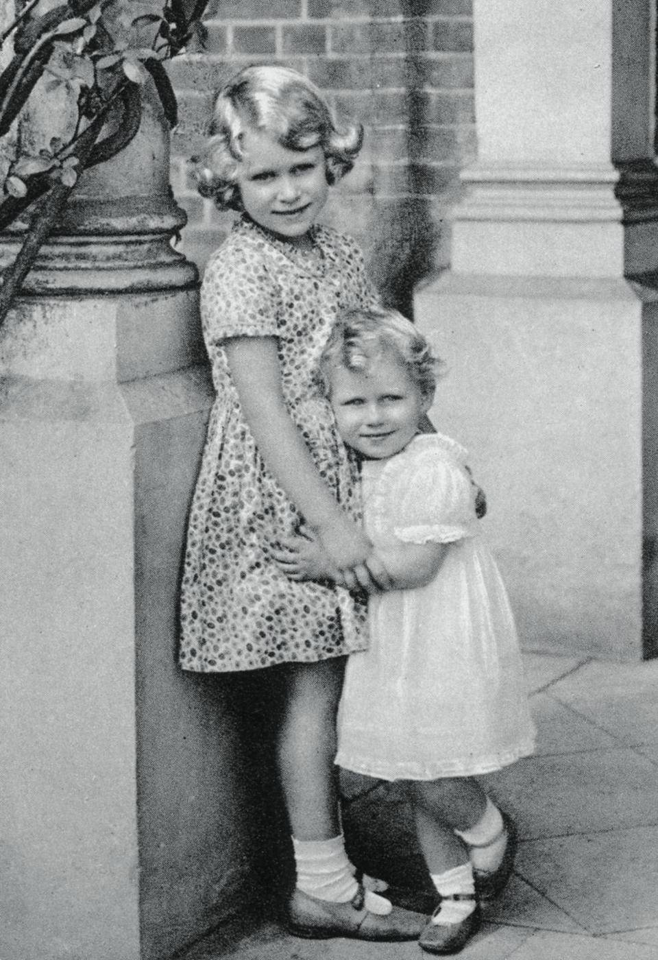 <p>In this photo, Princess Elizabeth is 6-years-old, hugging Margaret, then 2. </p>