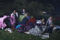<p>If your backyard can handle it, string up a white sheet for a movie screen and rent a projector to show your tween or teen's favorite movie. Have your guests bring sleeping bags so they can get comfy on the grass while watching the film. Provide some homemade popcorn and snacks to keep it festive.</p>