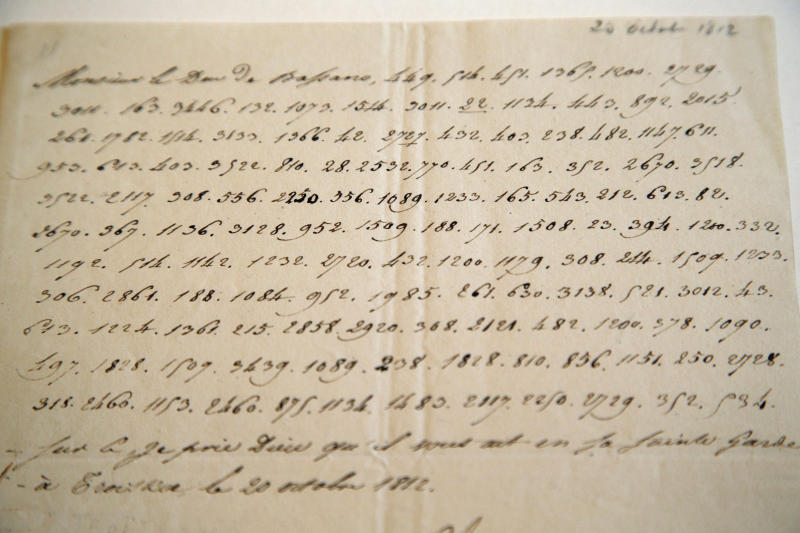 """In this photo taken Wednesday, Nov. 28, 2012, a letter dictated by Napoleon in secret code that declares his intentions """"to blow up the Kremlin"""" during his ill-fated Russian campaign is displayed in Fontainebleau, outside Paris. The rare letter, written in unusually emotive language, sees Napoleon complain of harsh conditions and the shortcomings of his grand army. The letter goes on auction Sunday, Dec. 2, 2012. (AP Photo/Christophe Ena)"""