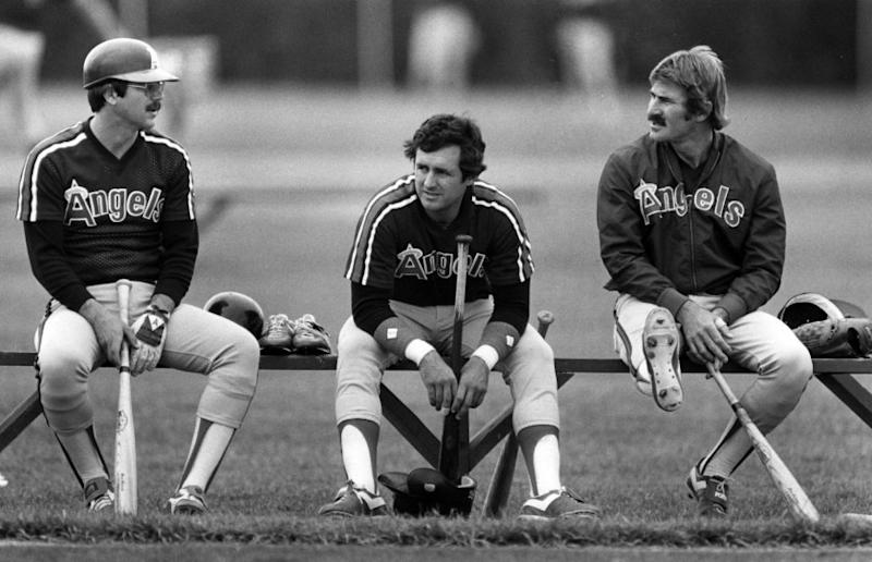 March 1983: Angels Tim Foli, left, Fred Lynn and Bobby Brich chat between batting practice during spring camp in Casa Grande, Arizona. This photo was published in the March 28, 1983 Los Angeles Times.