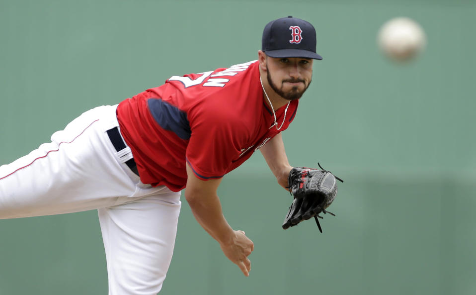 Boston Red Sox pitcher Brandon Workman delivers a warm-up throw in the second inning of an exhibition baseball game against Northeastern Thursday, Feb. 27, 2014, in Fort Myers, Fla. (AP Photo/Steven Senne)