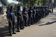 Bangladeshi police stand guard outside the International Crimes Tribunal in Dhaka, on February 28, 2013. The Bangladeshi court has sentenced a senior Islamist opposition official to death by hanging for crimes including genocide and torture during the 1971 liberation war against Pakistan