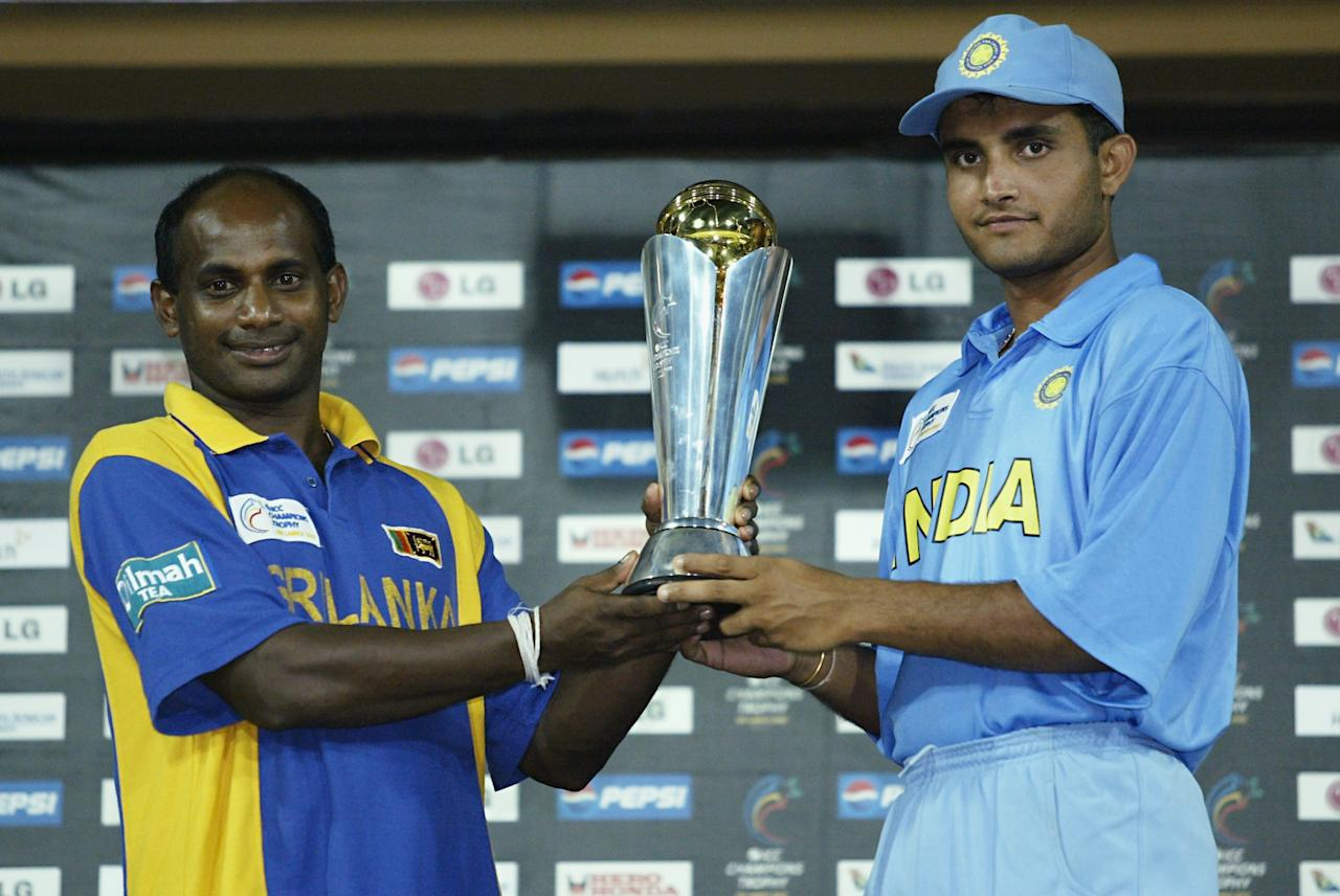 COLOMBO - SEPTEMBER 30:  Sanath Jayasuriya of Sri Lanka and Sourav Ganguly of India with the trophy after the re-scheduled ICC Champions Trophy final between Sri Lanka and India at the R. Premadasa Stadium in Colombo, Sri Lanka on September 30, 2002. (Photo by Clive Mason/Getty Images)  India and Sri Lanka share the ICC Champions Trophy after the rain washed out play.
