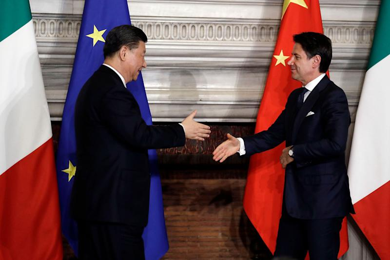 "Chinese President Xi Jinping, left, and Italian Premier Giuseppe Conte shake their hands at the end of the signing ceremony of a memorandum of understanding at Rome's Villa Madama, Saturday, March 23, 2019. Italy signed a memorandum of understanding with China on Saturday in support of Beijing's ""Belt and Road"" initiative, which aims to weave a network of ports, bridges and power plants linking China with Africa, Europe and beyond. (AP Photo/Andrew Medichini)"