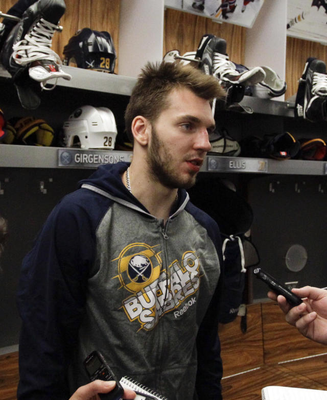 Buffalo Sabres center Zemgus Girgensons addresses the media during locker clean out day after players gathered for the last time on Monday, April 14, 2014, after the NHL hockey team clinched the NHL's worst record in Buffalo, N.Y. (AP Photo/Nick LoVerde)