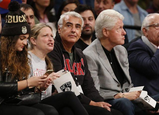 Marc Lasry (center) has been a Clinton ally for years. (Associated Press)