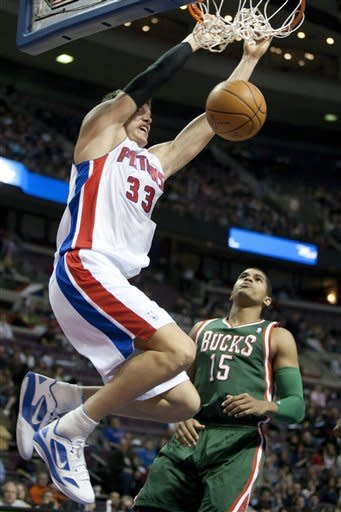 Detroit Pistons' Jonas Jerebko (33), of Sweden, dunks over Milwaukee Bucks' Tobias Harris (15) in the second half of an NBA basketball game on Friday, Feb. 3, 2012, in Auburn Hills, Mich. The Pistons defeated the Bucks 88-80 for their fifth win of the season. (AP Photo/Duane Burleson)
