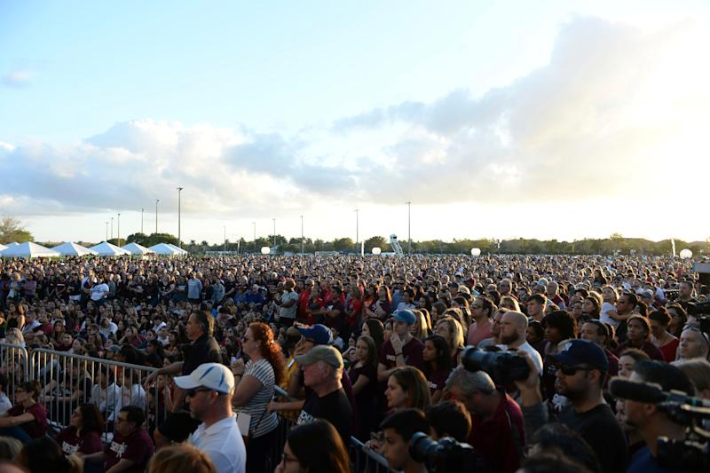 PARKLAND FL - FEBRUARY 14: Students and parents attend a memorial service at Pine Trails Park for the victims of the mass shooting at Marjory Stoneman Douglas High School on Valentines Day 2018 in Parkland, Florida. A year ago on Feb, 14th at Marjory Stoneman Douglas High School where 14 students and three staff members were killed during the mass shooting. on February 14, 2019 in Parkland, Florida. Credit: mpi04/MediaPunch /IPX