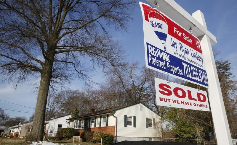 """Home """"SOLD"""" sign hangs in front of a house in Vienna, on the day the National Association of Realtors issues its Pending Home Sales for February report, in Virginia"""