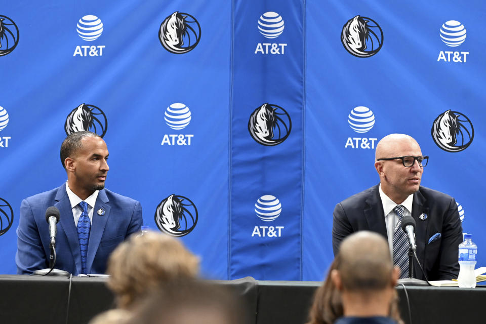 New Dallas Mavericks NBA basketball team general manager Nico Harrison, left, and new head coach Jason Kidd, right, are shown at an introductory press conference in Dallas, Thursday, July 15, 2021. (AP Photo/Matt Strasen)
