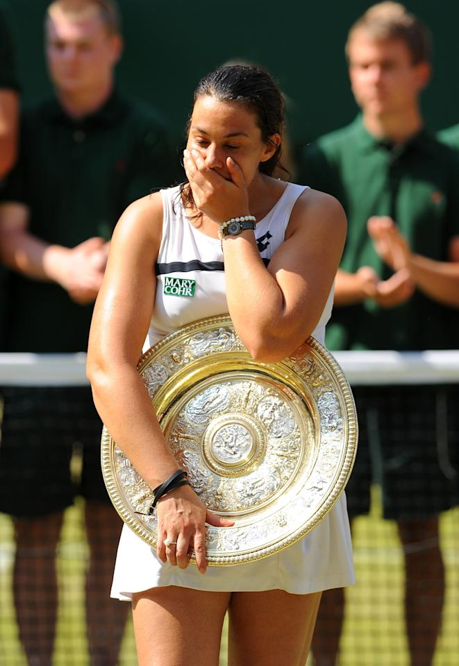 France's Marion Bartoli celebrates with her trophy after defeating Germany's Sabine Lisicki in the Ladies' Singles Final during day twelve of the Wimbledon Championships at The All England Lawn Tennis and Croquet Club, Wimbledon.