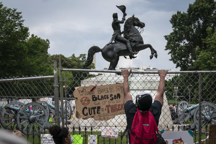 Protesters pull down a fence around the statue of Andrew Jackson in Lafayette Square near the White House on June 22. (Drew Angerer/Getty Images)