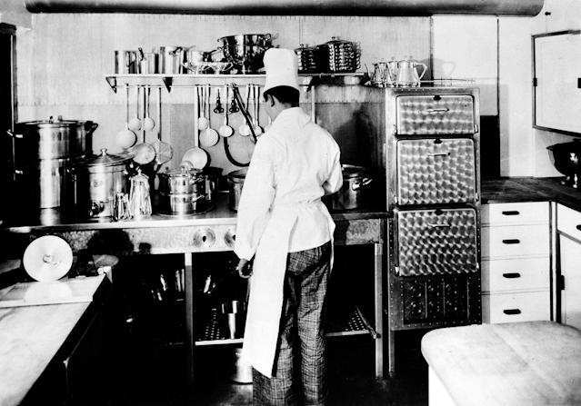 <p>A modern, electrically equipped kitchen aboard the zeppelin Hindenburg provides for the passengers and crew, seen in this undated photograph. The huge aircraft is scheduled to land the night of May 8, 1936, in Lakehurst, New Jersey, on the first of ten rounds between its home base in Germany and the United States. (AP Photo) </p>
