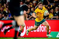 "Australia captain Michael Hooper powers past at tackle during the victory in Brisbane. ""We make no bones about where we want to go as a team and those guys are going to be a big driving factor in that,"" he said"