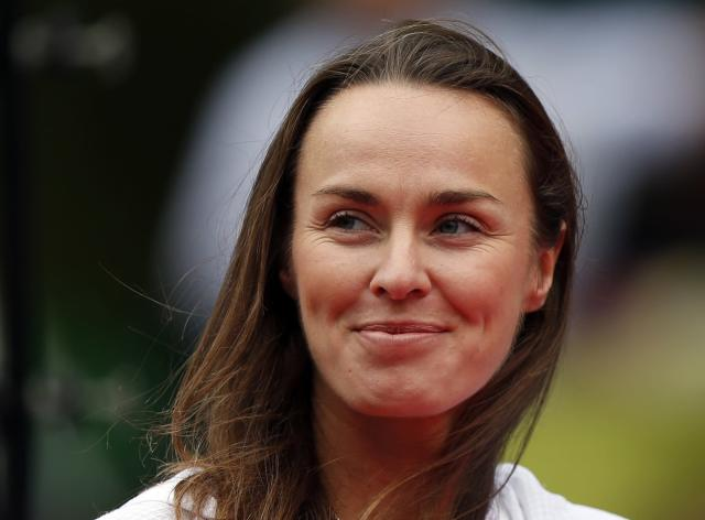 Martina Hingis of Switzerland smiles at a ceremony to celebrate the 30th anniversary of the Pan Pacific Open tennis tournament after the women's final match between Petra Kvitova of the Czech Republic and Angelique Kerber of Germany in Tokyo September 28, 2013. REUTERS/Toru Hanai (JAPAN - Tags: SPORT TENNIS HEADSHOT)