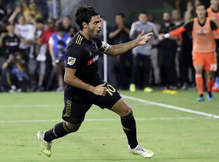 FILE - Los Angeles FC's Carlos Vela (10) celebrates after scoring against the Los Angeles Galaxy during the second half of an MLS soccer match in Los Angeles, in this Sunday, Aug. 25, 2019, file photo. No team in MLS can match the star power the duo of Diego Rossi and Vela bring. (AP Photo/Marcio Jose Sanchez, File)