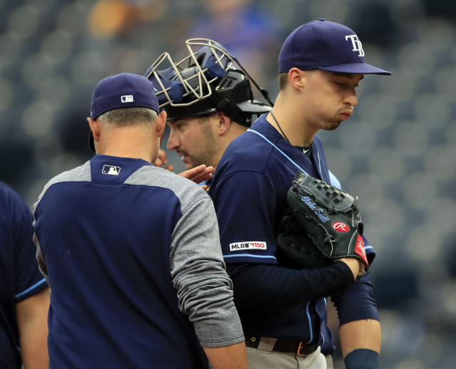 FILE - In this May 1, 2019, file photo, Tampa Bay Rays starting pitcher Blake Snell, right, is taken out by manager Kevin Cash, left, during the fourth inning of a baseball game against the Kansas City Royals at Kauffman Stadium in Kansas City, Mo. Rays All-Star pitcher Blake Snell says he will not take the mound this year if his pay is cut further, proclaiming: Im not playing unless I get mine. the 2018 AL Cy Young Award winner said on a Twitch stream Wednesday, May 14 2020. (AP Photo/Orlin Wagner, File)