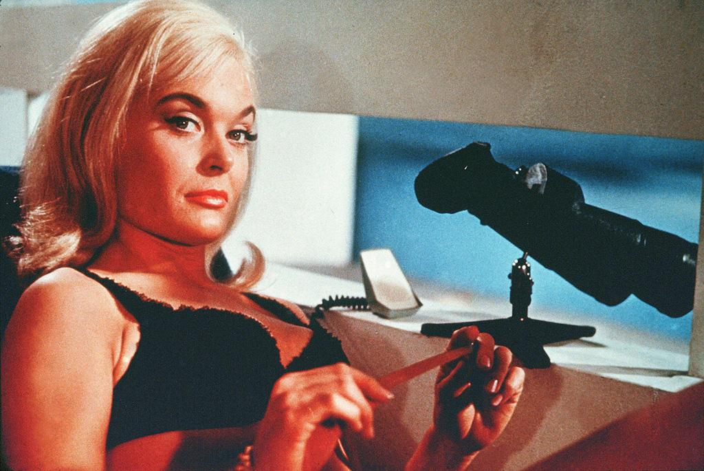 """JILL MASTERTON   MOVIE: <a href=""""http://movies.yahoo.com/movie/1800071536/info"""">Goldfinger</a>  ACTRESS: <a href=""""http://movies.yahoo.com/movie/contributor/1800014102"""">Shirley Eaton</a>  ALLEGIANCE: Auric Goldfinger  LAST SEEN: Dead, covered in gold paint.  SPECIAL SKILLS: Cheating at cards, sunbathing."""