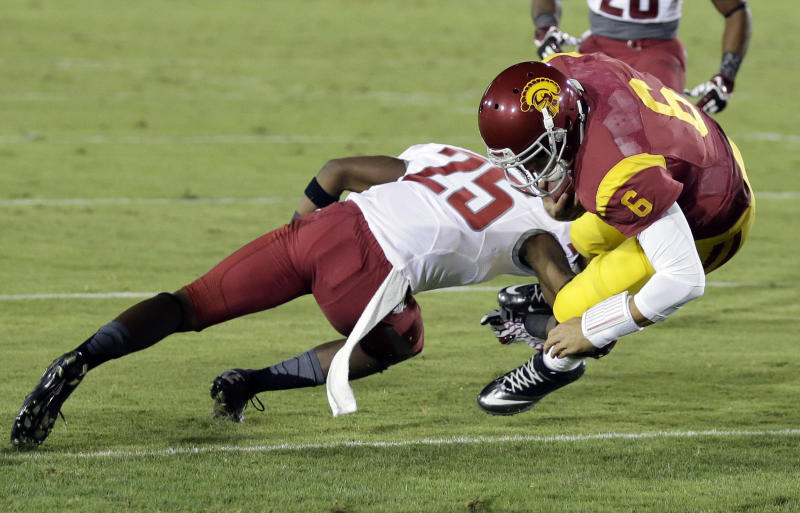 Southern California quarterback Cody Kessler, right, scores past Washington State cornerback Daquawn Brown during the first half of an NCAA college football game in Los Angeles, Saturday, Sept. 7, 2013. (AP Photo/Chris Carlson)