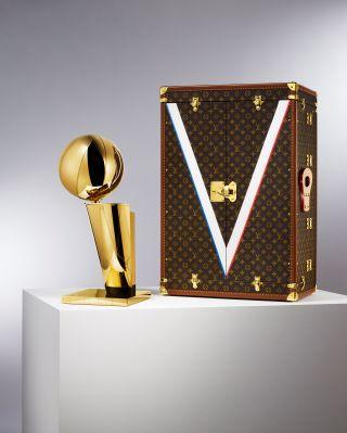 Louis Vuitton's travel case next to the NBA's championship trophy