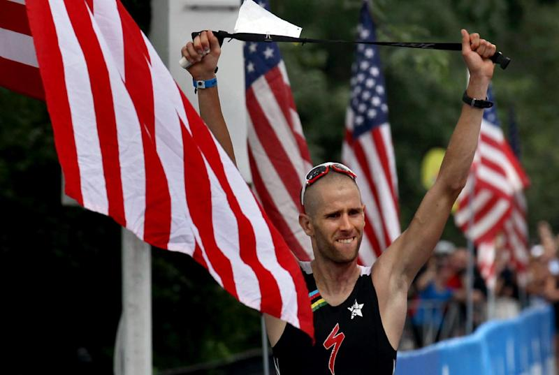 Jordan Rapp raises his arms just before winning the Ironman U.S. Championship triathlon in New York, Saturday, Aug. 11, 2012. (AP Photo/Craig Ruttle)