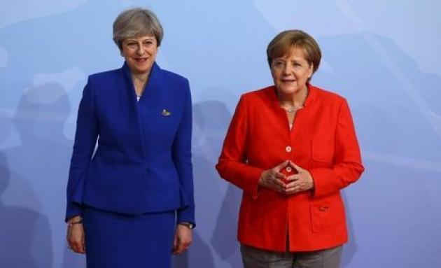 Britain, Germany committed to Iran nuclear deal: May's office
