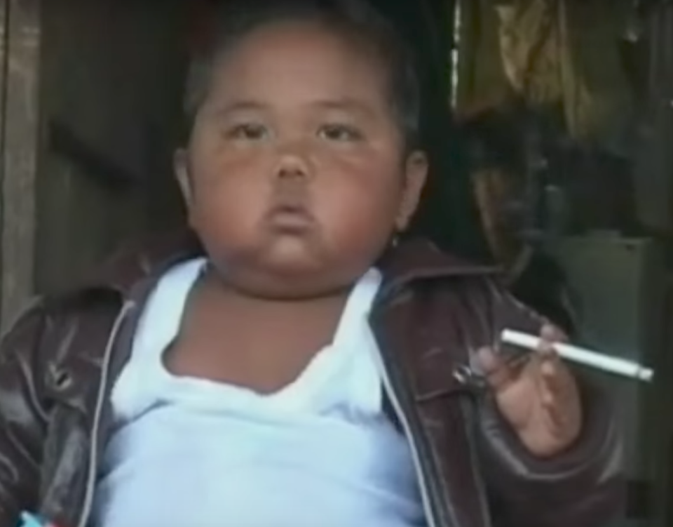 <em>Chain-smoker – Aldi's addiction at the age of two made headlines around the world (Pictures: YouTube/ITN)</em>