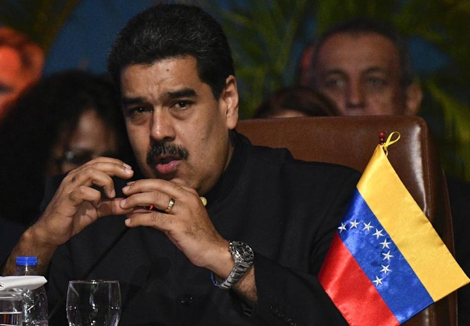 Falling oil prices and corruption have decimated the economy in Venezuela under President Nicolas Maduro, shown in this November 24, 2017 file photo (AFP Photo/AIZAR RALDES)