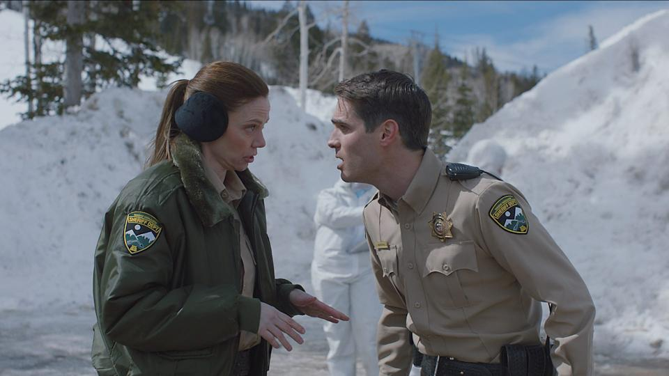 """John Marshall (Jim Cummings, right, with Riki Lindhome) is a stressed-out cop in the horror comedy """"The Wolf of Snow Hollow."""""""