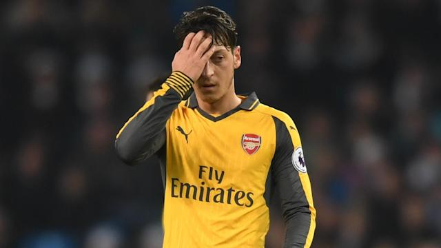 Mesut Ozil's Arsenal performances get too much attention, according to Arsene Wenger, but the manager says that can also work in his favour.