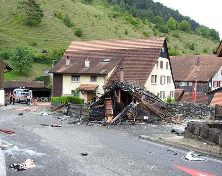 Parts of one of the two planes which crashed during an air show are seen in the village of Dittingen, Switzerland, in this handout photo provided by Kantonspolizei Basel Landschaft on August 23, 2015. REUTERS/Kantonspolizei Basel Landschaft/Handout via Reuters