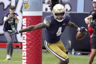 Notre Dame wide receiver Kevin Austin Jr. celebrates his touchdown reception from quarterback Drew Pyne during the second half of an NCAA college football game against Wisconsin Saturday, Sept. 25, 2021, in Chicago. Notre Dame won 41-13. (AP Photo/Charles Rex Arbogast)