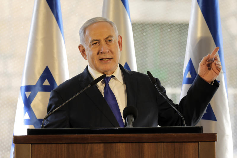 Israeli Prime Minister Benjamin Netanyahu, gestures as he speaks during a ceremony near Hebron's holiest site, known to Jews as the Tomb of the Patriarchs and to Muslims as the Ibrahimi Mosque in the Israeli controlled part of the West Bank city of Hebron, Wednesday, Sept. 4, 2019. Israel's prime minister is visiting the volatile West Bank city of Hebron under tight security in a move widely perceived as a bid to garner support from ultra-nationalists ahead of next month's elections. (AP Photo/Tsafrir Abayov)